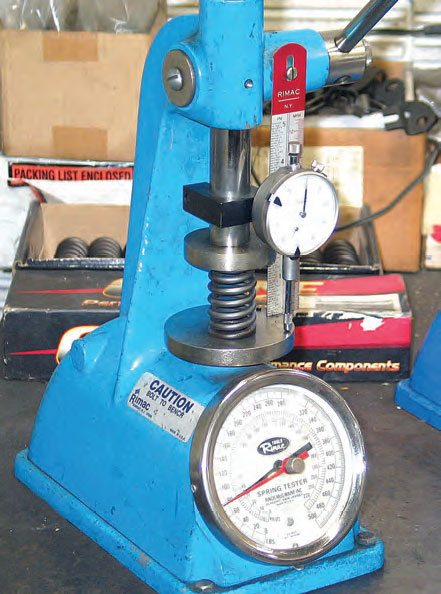 Each valvespring must be checked on a spring tester. The spring is compressed to its specified installed height while recording spring pressure.