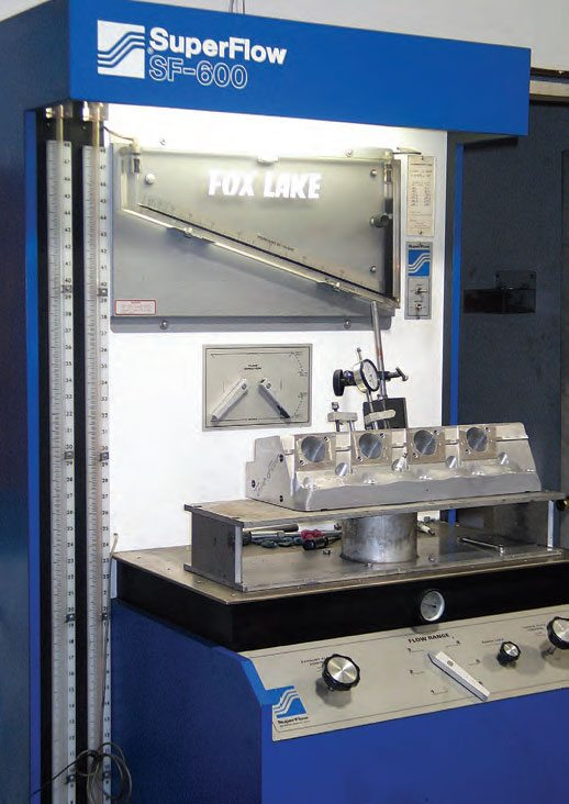 Flow benches measure intake and exhaust port airflow at various stages of valve lift (including max lift). This allows the head specialist to verify and record original flow and to verify the results of porting modifications. Without a flow bench, modifying ports is a guessing game. This is a SuperFlow SF-600 flow bench at Fox Lake Performance's cylinder-head shop. The two levers on the lower wall of the unit allow pressure to be diverted to the intake or exhaust paths.