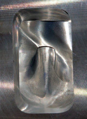 This view down the intake port shows the form of the shear dam (above and to the left of the guide boss). To arrive at a shape that does not impede airflow to any extent, and shears the fuel in the manner required, can use up a lot of R&D time. Taking the shear dam out of this Ultra Pro Machining 7-liter Chevrolet Corvette port actually reduced flow.