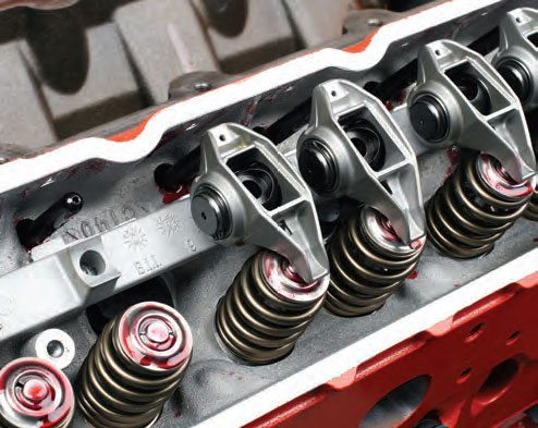 Depending on the version of your LS cylinder heads, some have integral rocker pedestals while others require separate pedestal rails. This 5.3L LS has rocker rails. Hand-snug a couple of rocker bolts to center the rail before fully tightening. Also, be sure to apply high-pressure assembly lube to all valve tips, rocker pushrod cups, and rocker valve tips.