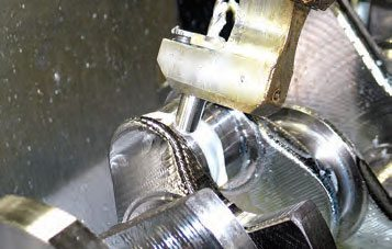 Computer-aided machining control places oil passages at required intersecting points.