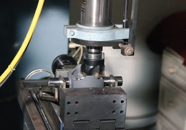 If weight must be removed from a piston, material can only be removed from an area where strength isn't compromised. The underside of the pin bosses can be shallow spot-faced, or a radial cutter can be used to remove an equal amount of weight from both bosses.