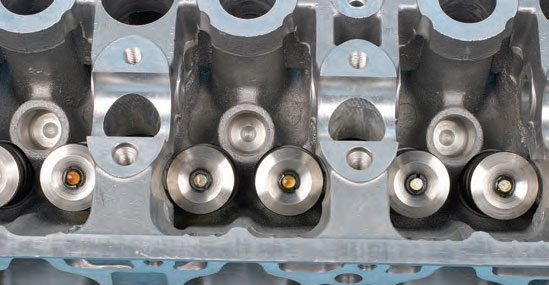 Special spring compressors are required when removing/installing valves and springs on many OHC cylinder heads because of the tight confines.