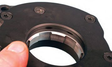 Crank-driven oil pumps have a driven gear that have a series of broad teeth.