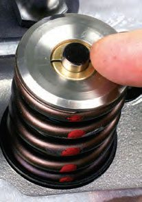 Before installing the rockers, clean the valve stem tips and paint them with a black marker. This provides a witness mark when the rocker sweeps across the valve tip.