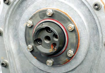 A retaining plate is mounted; it has a seal at the cam hub. The thrust washer(s) is/ are located between the hub and retaining plate.