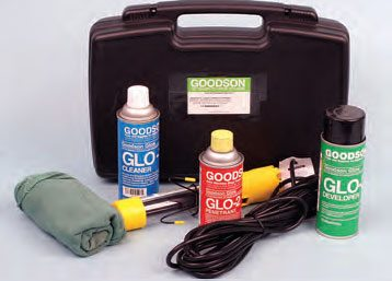 A dye penetrant kit. This is Goodson's Glo-Kit, complete with cleaner, penetrant, developer, a supply of rags, and an ultraviolet light.