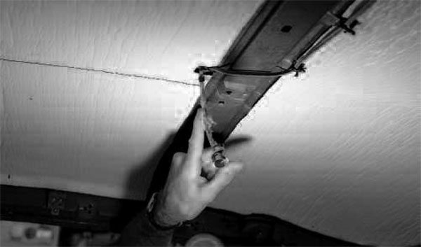 Now's your chance to clean up the underside of the roof; you won't have access to that sheetmetal once the headliner is installed. For headliners anchored by teeth, prepare the roof by straightening any bent teeth and repairing any broken teeth. To save time and effort later in the installation process, insert the screws for the trim, dome lamp, and sun visors now.