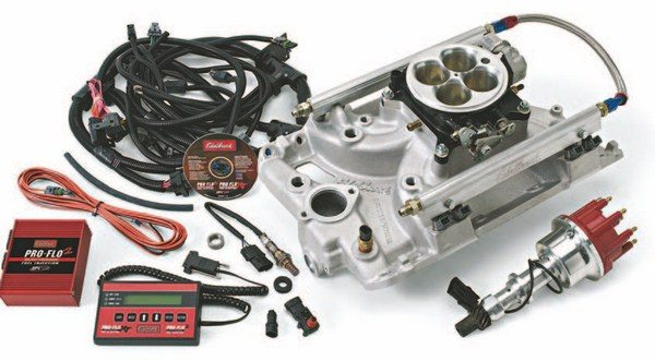 Fig. 1.14. This Edelbrock Pro-Flo 2 EFI system is available for Pontiac 326- to 455-ci V-8s. This complete MPFI system includes a single-plane intake manifold with injectors located in the intake runners, fuel rails, throttle body, Mallory distributor with cam sensor, programmable ECU, and handheld calibration module. Two versions of this kit are offered, depending on maximum horsepower, as well as similar kits for AMC, small- and big-block Chevy, AMC/Jeep, small- and big-block Chrysler, and small- and big-block Ford. (Photo Courtesy Edelbrock)