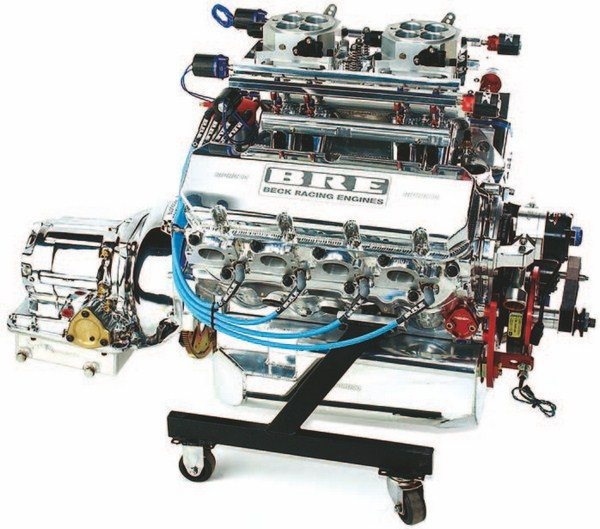 Fig. 1.18. This big-block Chevy sports dual throttle bodies from Accufab, 96-pound Siemens fuel injectors, and custom-fabricated intake and fuel rails. Engine management on this direct-injected nitrous application is handled via a Big Stuff 3 controller and harness. Notice the MSD crank trigger to keep timing spot on. This engine was built and tuned by Beck Racing Engines.