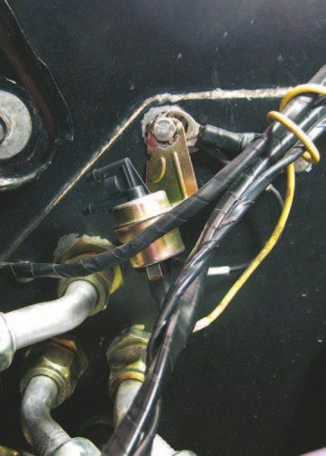 Fig. 2.26. Note the ground lugs behind the mounting bracket, which is mounted to the block-off plate for the aftermarket A/C system, which is sealed to the firewall with caulk. Not only is this a poor ground location, the lugs were so loose that you could spin them around by hand. As if that weren't bad enough, the ECU and MSD Digital 6AL were grounded via the same lug. The ECU and ignition box require separate grounds to operate properly.