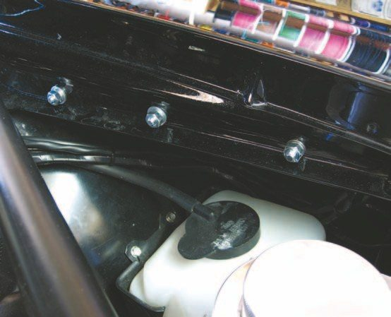 Fig 2.34. The box bolts up inside the inner fender and out of sight as the owner wanted but the plug is easily accessed and removed if needed.