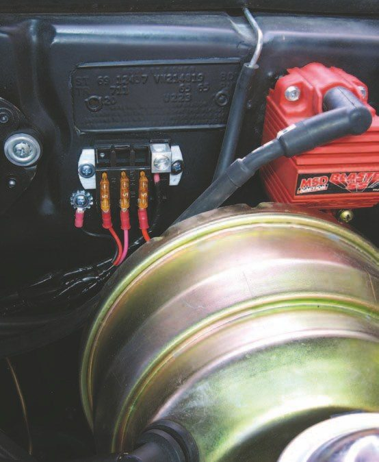 Fig. 2.36. I mounted a small fuse panel behind the brake booster. This supplies switched power to the ignition box, tach adapter, and the switched side of the coil for the fuel pump relay.