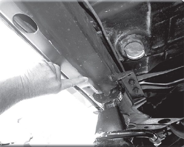 The fi nger points out the boxed side rails of Oldsmobile's optional F-35 Guard Beam heavy-duty frame. Standard under every convertible, each GM division offered similar frames under fi xed-roof bodies as well. But was the F-35 boxed frame included with the 1966 W-30?