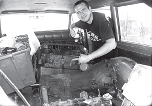 This happy fellow is pointing to AMC's easy engine-block identifi cation system.