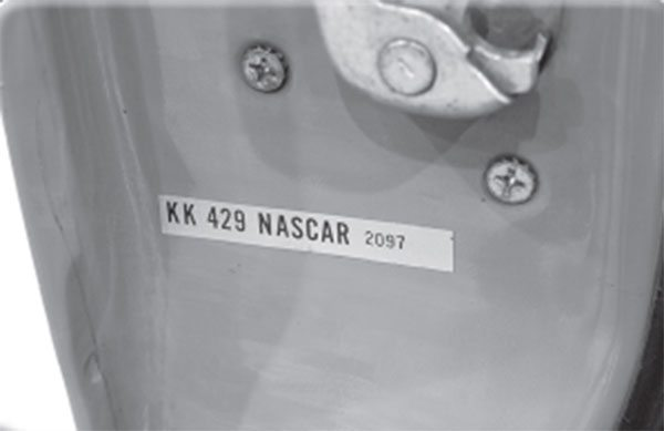 This Mustang door sticker was applied by Kar Kraft, which has nothing to do with the popular car magazine.