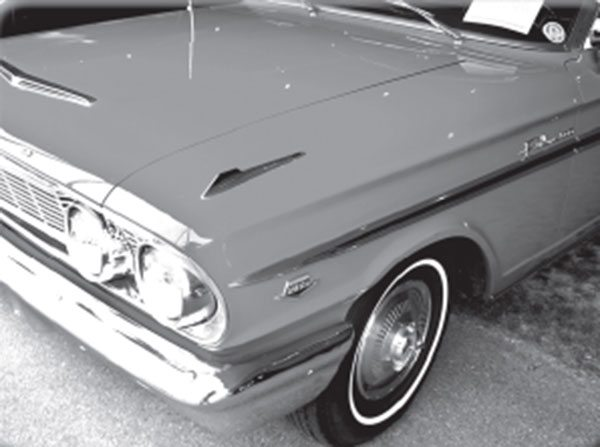 The discreet fender emblem marks this 1964 Fairlane as a K-code 289 High Performance model. How is it related to a 427 Thunderbolt?