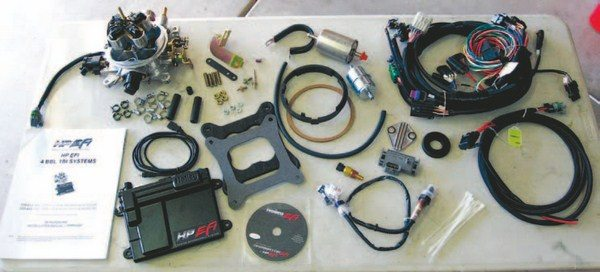 Fig 4.1. Here are the components of the Holley HP EFI system on my Olds. This system is easy to install, easy to tune, offers excellent drivability and performance, and has performed flawlessly. Not shown is the slave throttle body assembly.
