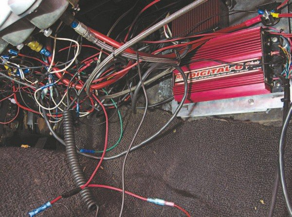 Fig. 6.7. Bill has been after me for a long time to help him get his underdash wiring sorted out. So I ripped it all out and redid everything. Don't even consider taking on a project of this scale if the wiring under the dash of your vehicle looks anything like this.
