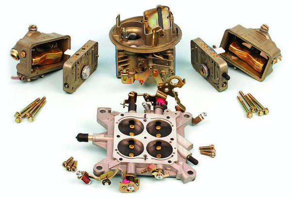 This Holley 4-barrel carb 4150 (PN 4779) is disassembled into its basic components. This carb has mechanical secondaries and a manual choke. At the bottom center is the baseplate, also called the throttle body. At the top center is the main body. The primary fuel bowl and metering block are at the right and the secondary fuel bowl and metering block are at the left.