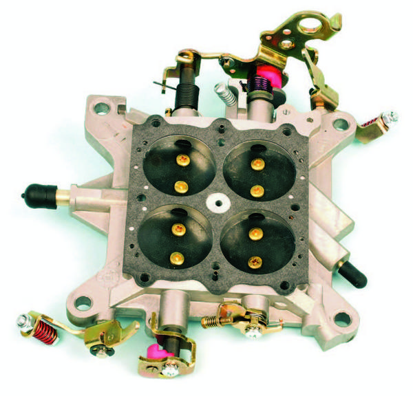 This is a baseplate from a 4150 Double Pumper. The baseplate, also known as the throttle body, is the foundation for a carb and incorporates the throttle shafts and throttle plates.