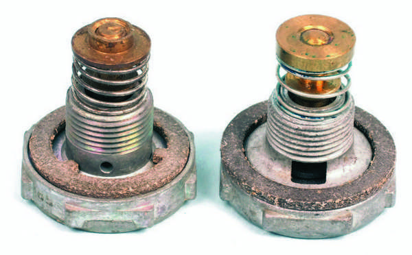 On the left is a two-stage power valve with small orifices. On the right is a power valve with a large window passage. The type with small holes is primarily designed to improve part-throttle economy on vehicles with heavy loads and isn't the best choice for a performance application. The gasket style differs as well. The correct gasket must be used depending on style of power valve. If the gasket is incorrectly matched to the power valve, it leaks. The gasket with a concentric inside diameter is used with a power valve that has the larger window fuel opening. The gasket with three small tangs on the inside diameter seats properly onto the power valve with the series of small fuel orifices.