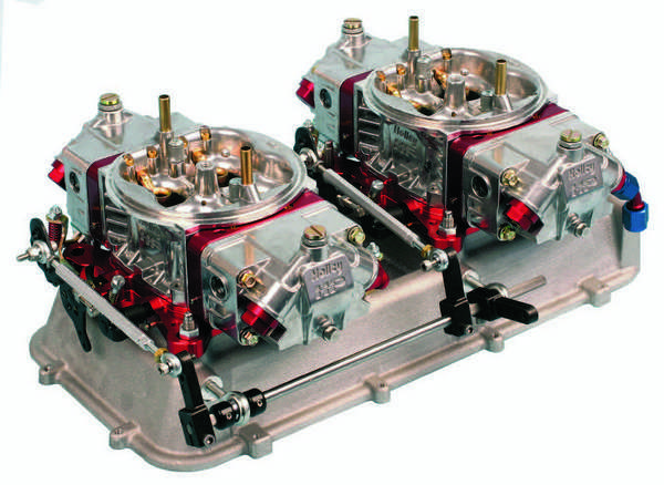 A dual-carb layout may involve mounting the carbs in-line or sideways, depending on the design of the manifold or the specific application. This is a pair of Holley Ultra HP carbs mounted sideways.