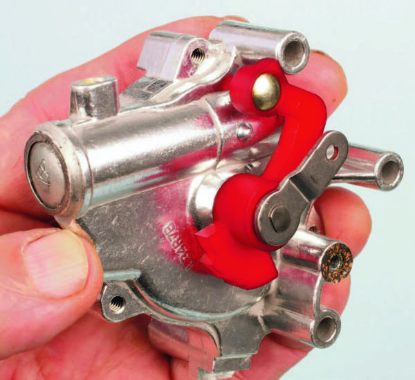 The fast-idle cam is found on the rear of the choke housing. The plastic cam includes a series of steps that contact the fast-idle cam adjusting screw pad. On initial cold start, the cam's highest step contacts the adjuster screw arm's pad. As the engine warms, the cam progressively steps down until the choke plate is fully open.