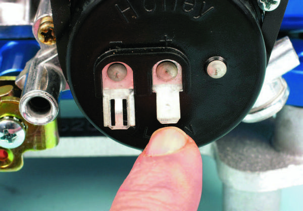 The choke cap has two terminals. Each is marked on the cap for negative and positive (indicated) connections. The positive power terminal must be connected to a 12-volt positive power source that activates with the ignition in the ON position. Do not connect the choke's positive to the ignition coil's positive post.