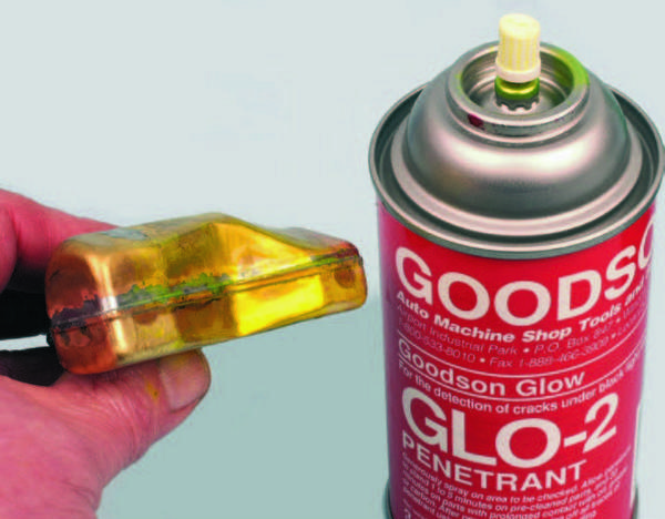 A simple aerosol dye-penetrant flaw-detection kit can prove to be handy for inspecting any component that you suspect has a crack or hole. Goodson's kit is an example. First, you spray the surface with the cleaner. This is simply a fast-evaporating solvent that removes any surface contaminants and prepares the surface for the dye. Next, you spray the dye onto the surface and allow it dry for about a minute.