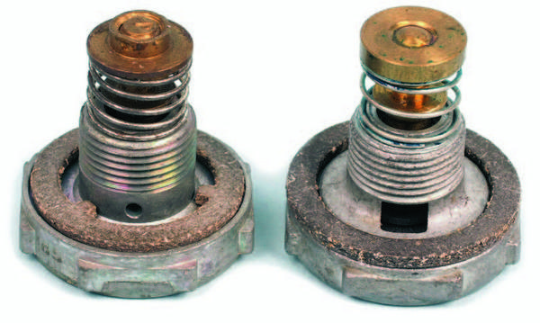 Holley carbs may have one of two styles of power valves. On the left is a two-stage power valve with small orifices. On the right is a power valve with the large window passage. The version with small holes is designed primarily to improve part-throttle economy on vehicles with heavy loads and isn't the best choice for a performance application. The gaskets differ in shape between the two versions. The correct gasket must match the style of power valve.
