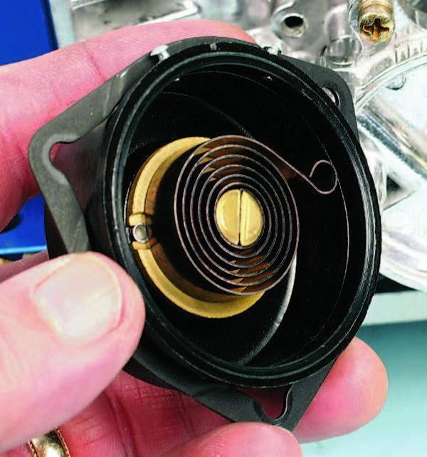 The temperature-sensitive thermal spring adjusts carb richness according to the ambient temperature so it needs to be in good working order. Inspect the thermal spring inside the electric choke cap. If it is distorted or shows signs of unwinding, replace it. New caps with springs are readily available.