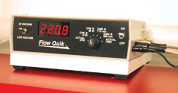 Fig. 3.10. The Flow Quik's readout. The reading shown here is corrected to 28 inches depression. The selector knob on the right of the unit allows a 10or 28-inch correction to be shown as well as the metric equivalent.
