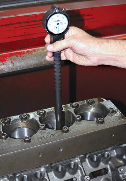 Cylinder bores are measured with a dial bore gauge to obtain maximum accuracy. Measurements are taken at the top, center, and bottom of piston travel and in two different directions, front to back and side to side.