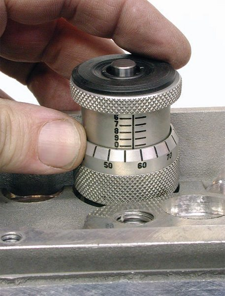 A valvespring height micrometer checks actual valvespring installed height with the correct valvespring retainer. It provides a direct readout on a micrometer-like scale.