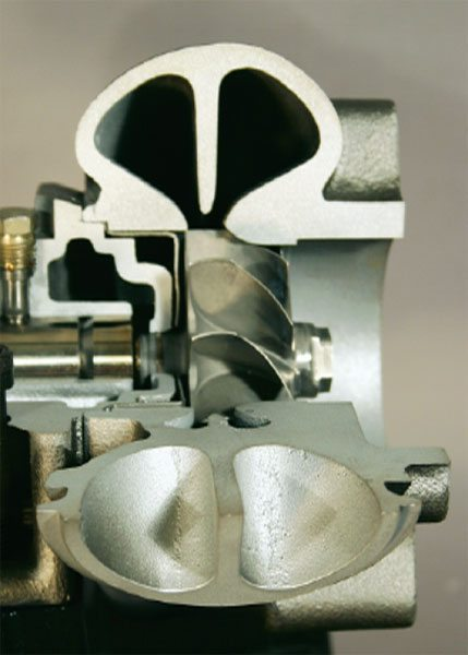 The turbine section of a turbocharger consists primarily of the turbine wheel and turbine housing. This 120-degree cutaway section illustrates the turbine wheel position relative to the turbine housing. (Courtesy Diesel Injection Service Company, Inc.)