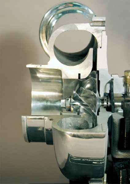 The compressor section of a turbocharger consists primarily of the compressor wheel and compressor cover. (Courtesy Diesel Injection Service Company, Inc.)