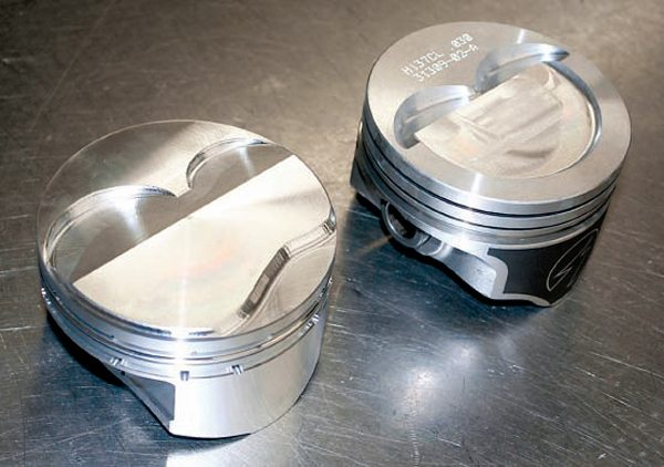 This comparison between a domed piston and a dished piston illustrates how the dome projects into the combustion chamber to raise compression by reducing chamber volume while the dished piston increases combustion space volume to reduce compression ratio.
