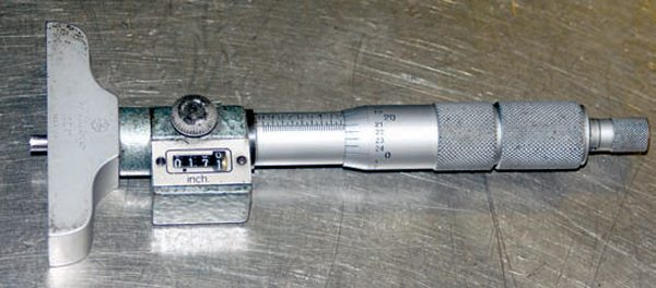 A depth micrometer makes quick work of checking piston deck height and piston rock. They're also useful for checking-the depth of blind head bolt holes and other depth measurements.
