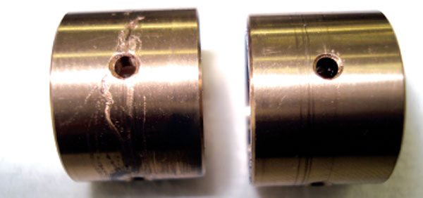 The journal bearings will typically show obvious markings when contaminated lube oil is at fault. The heavier scoring will be noticed on the bearing OD because of the entrapment of larger particles. If contaminated lube oil is the cause of failure, you'll typically see some level of scoring on all internal bearing surfaces. (Courtesy, Honeywell Turbo Technologies)
