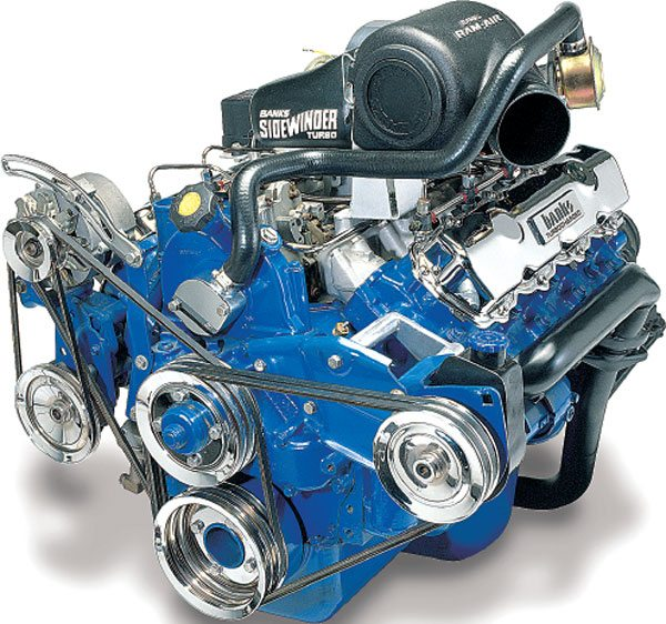 "Gale Banks Engineering also manufactured a turbo retrofit kit for the 6.9/7.3-liter indirect-injected diesel made by International Truck and Engine for Ford trucks. The turbocharger used in this kit is the same T04B25 model turbocharger as used in the GM 6.2-liter kit. While this illustration does not show the actual turbocharger, Banks positioned the turbo on his redesign of the 7.3-liter kit in a superior manner than in his previous kit design where the turbocharger was positioned at an angle rear of the intake manifold. This facilitated improved intake and exhaust plumbing to enhance overall turbo system design. The twisted angle Banks used on the 7.3 turbo kit redesign was the origin of the ""sidewinder"" name as it now applies to Banks' turbocharged light truck engines. This kit is not aftercooled due to the mild boost. Once turbocharged, both the 7.3 Ford and the 6.2 GM diesels produced about 50 percent more horsepower. The slightly higher power and displacement of the 7.3 diesels, once turbocharged, created the most powerful light-duty truck engine package of the mid 1980s, gasoline or diesel. (Courtesy Gale Banks Engineering)"