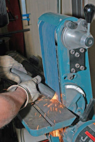 A belt grinder is useful for cleaning up rough gas and plasma cuts, and shaping parts for welding and direct use.