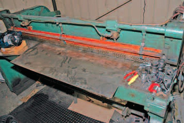 A large free-standing shear allows you to cut straight lines in sheet metal up to 6 or 8 feet long.