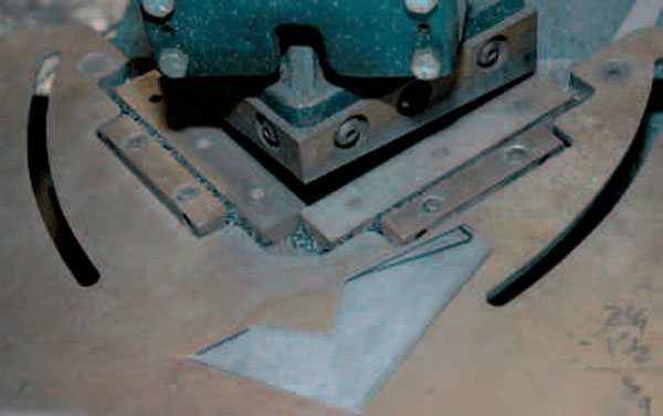 This notcher is used to cut perfect 90-degree angles (or other shapes by replacing the dies) out of sheet metal. This is useful when you're creating boxes and other shapes that require removing sections of metal.