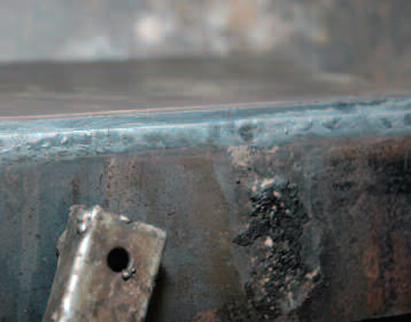 Look at the light colored metal at the edge of this piece. You can see that the weld on the other side penetrated the underlying metal when you can see an outline of the weld from the back of the piece.