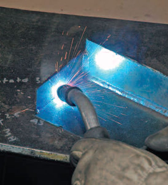 Inside angle welds are very much like fillets, except the assumption is that only the edges are touching when you start. Often, welders will reinforce inside angle welds by laying two more beads on top of the first, making a larger triangular cross-section.
