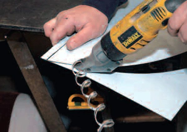 Power shears are the best tool going for cutting sheetmetal, but they cost more than a nibbler, and a lot more than a set of hand shears.