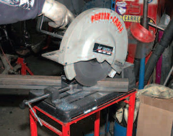 A chopsaw is generally cheaper than a steel-cutting bandsaw, and works just as well. You can also get by with a table saw or circular saw, but a chopsaw works better for mitered cuts.