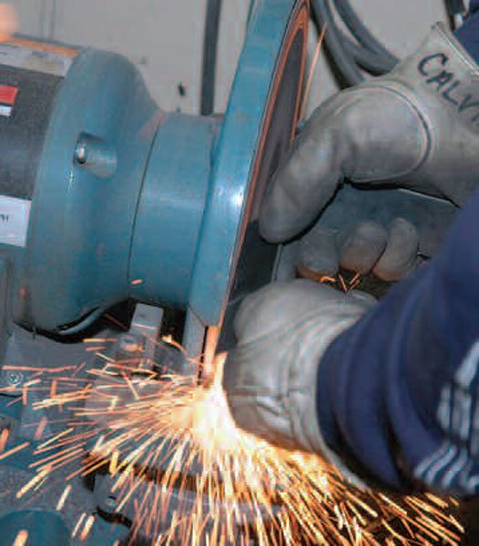 A disc grinder (or belt grinder) is the right tool for putting a consistent bevel on pieces to be welded.