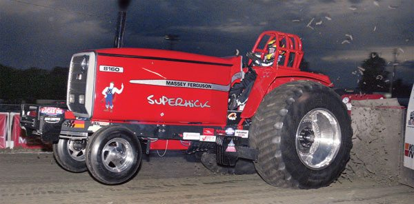 David Batliner of Floyds Knobs, Indiana, runs a Massey Ferguson pulling tractor called Superhick in the Super Farm class with a specially modified turbo from Columbus Diesel Supply. Note the mud being flung off the tires at the beginning of the pull. The driver must manually slip the clutch during take-off to balance between maximum acceleration and minimum wheel spin while keeping the engine RPM up.